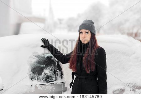 Upset Woman Removing Snow from a Car Window