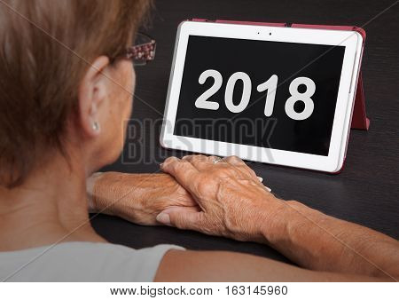 Senior Lady Relaxing And Her Tablet - 2018