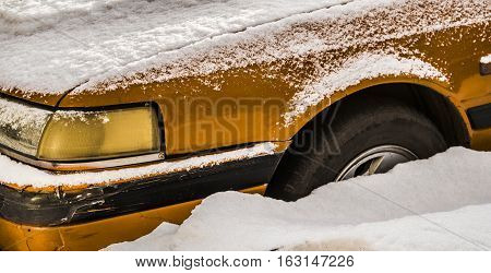 Yellow car, fender of old yellow car, bright golden old car in snow, old-fashioned car, yellow oldtimer