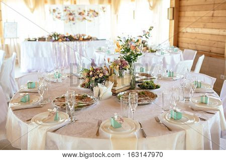 Wedding table appointments with beautiful decor and flowers