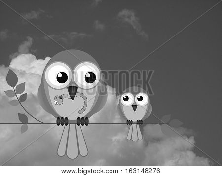 Monochrome Mother bird feeding her young with a worm against a cloudy sky