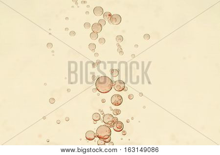 Beautiful light red bubbles over a blurred background