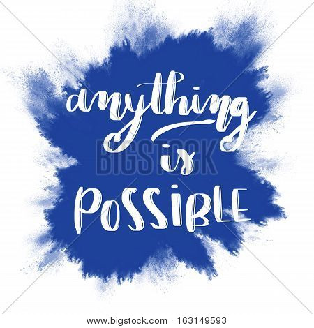 Anything is possible inspirational message on blue splash background