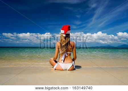 Woman on the Beach with Santa Claus Hat
