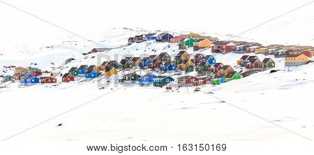 Colorful Cabins On The Hill Covered In Snow, Aasiaat City, Greenland
