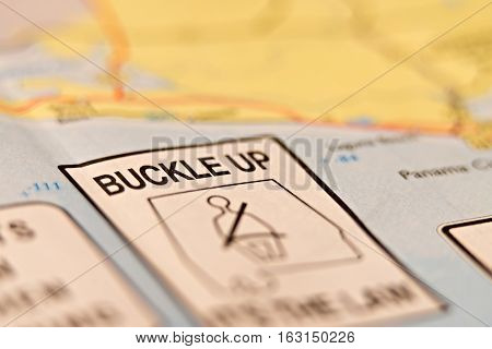 a buckle up warning sign on a map