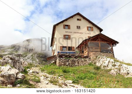Sexten, Italy - August 1, 2016: Alpine Hut Zsigmondyhutte in Sexten Dolomites. The Zsigmondyhutte is a mountain hut on the rock ridge of the Zwolferkofel. The hut is named after the Viennese alpinist Emil Zsigmondy.