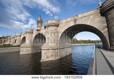 Views of Toledo Bridge Puente de Toledo in Spanish over Manzanares River Madrid Spain. It was built in XVII century.