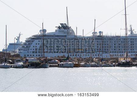 Cruise ship and yacht in the bay of Mandraki. Rhodes, Greece