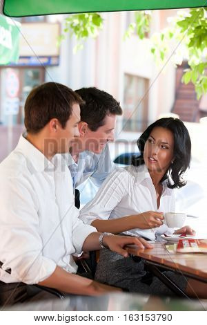 Young people sitting at the table and talking