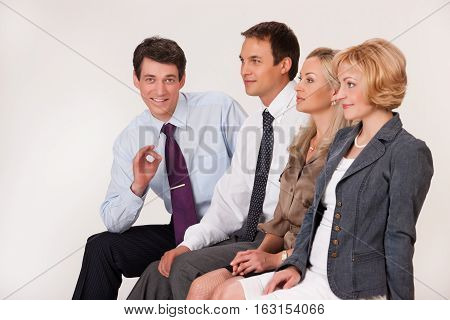 Group of young men and women on isolated background