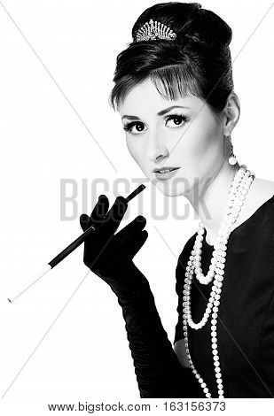 Portrait Of A Beautiful Young Woman In Retro Style With Cigarette In Mouthpiece In The Image Of The