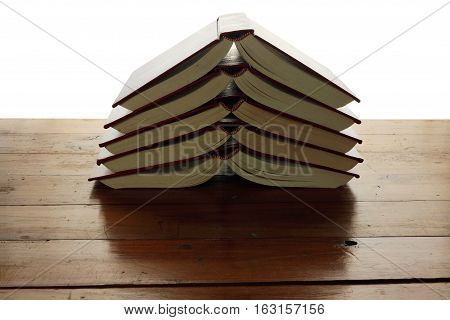 Stack of Books on Rustic Wood Background