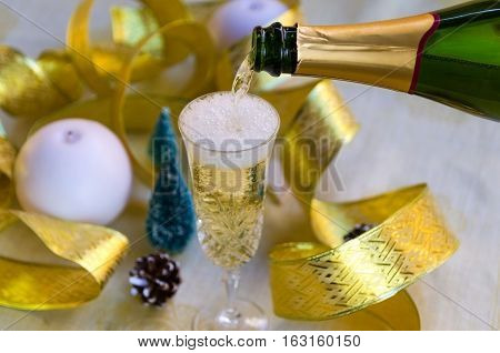 Champagne pouring in two glasses. Concept for New Year celebration. Champaign background.