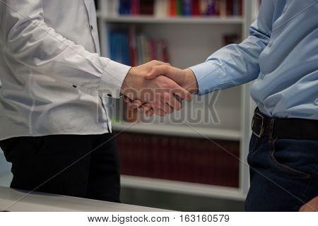 Strong Handshake Of Two Men