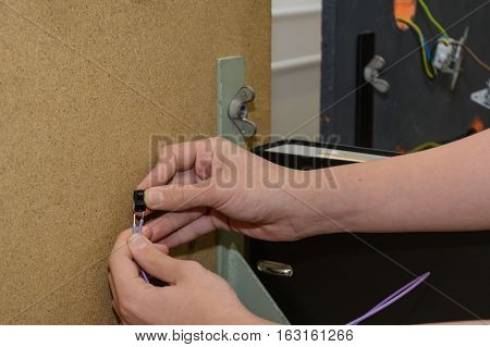 Electrician installing a power connector - close-up clamp