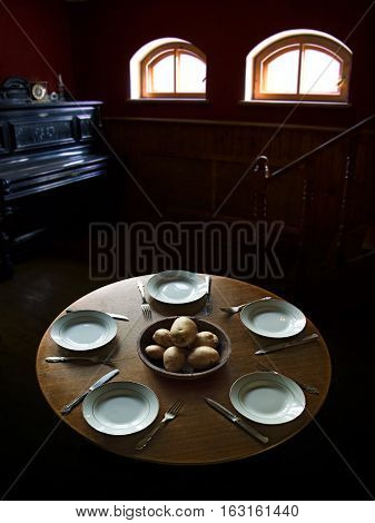 a modest lunch for five people near piano