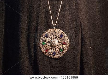 Silver Big Pendant Medallion On The Black Background