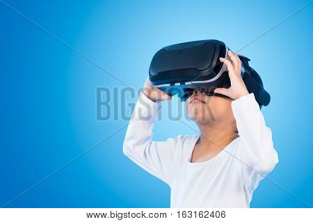 Asian Chinese Little Girl Experiencing Virtual Reality Eyeglassses