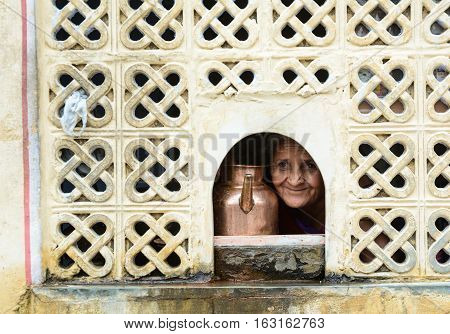 India Woman With Water Pot In Old House