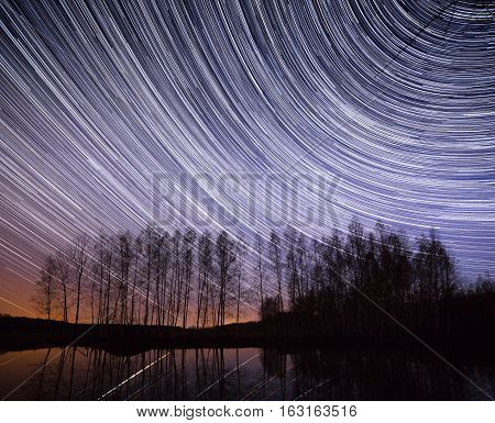 Star Trails Over Lake