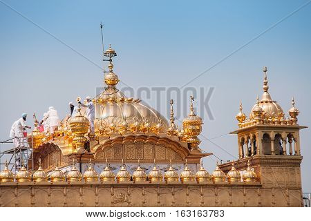Amritsar, India - AUGUST 15: Cleaning service on the cupola of Golden Temple (Harmandir Sahib) on August 15, 2016 in Amritsar, Panjab, India.
