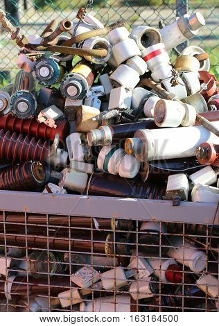 Full Basket In A Landfill With Ceramic Material And Old Electric