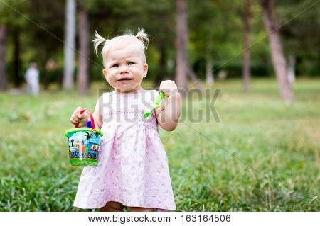 Small Cute Baby Outdoors In The Park