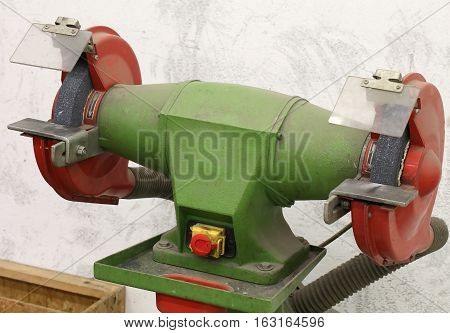 Grinder With Grinding Wheel For Machining Of Metals