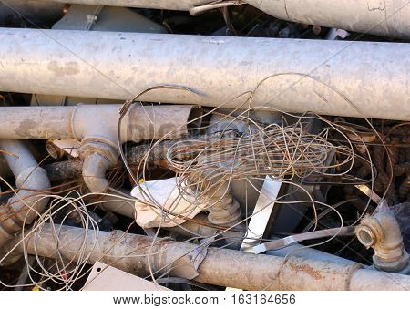 Iron Pipes And Other Ferrous Material In A Landfill To Recycle