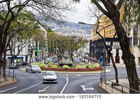 FUNCHAL PORTUGAL - JUNE 14 2013: Avenida Arriaga street in the center of Funchal city the capital of Madeira island Atlantic ocean Portugal