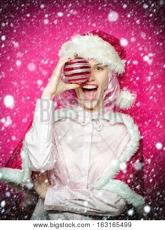 Excited Girl With Christmas Bauble
