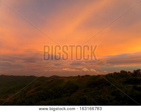 Stunning Orange and Purple of Sunset Afterglow over the Mountain Range in Thailand