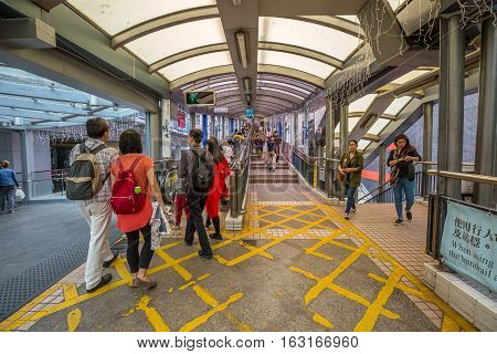 Hong Kong, China - December 4, 2016: the beginning of Mid-Levels escalator and walkway system on Queen's Road Central in Hong Kong, the longest outdoor covered escalator system in the world.