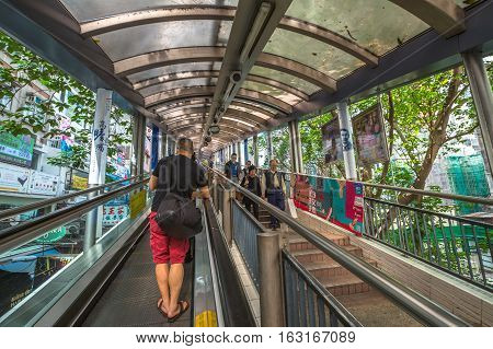 Hong Kong, China - December 4, 2016: People using the Centra Mid Levels escalator in Hong Kong, the longest outdoor covered escalator system in the world.