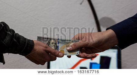 Two Guys Or Businessmen Trade Exchange Dollars From Hand To Hand Economy