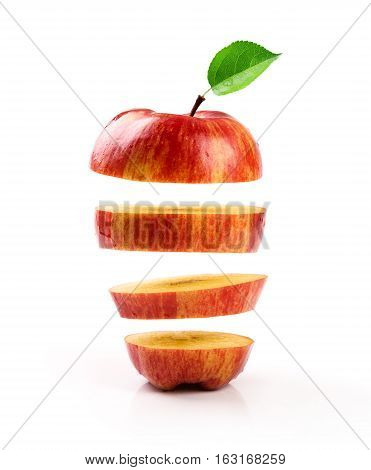 sliced red apple levitating on white background