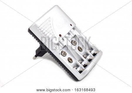 grey plastic battery charger on white background