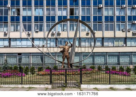 Kyiv Ukraine - Yuly 30 2014: Monument to Petr Nesterov in front of Kiev Aviation Plant. He's a Ukrainian pilot aircraft designer and aerobatics pioneer who first performed Nesterov Loop maneuver.