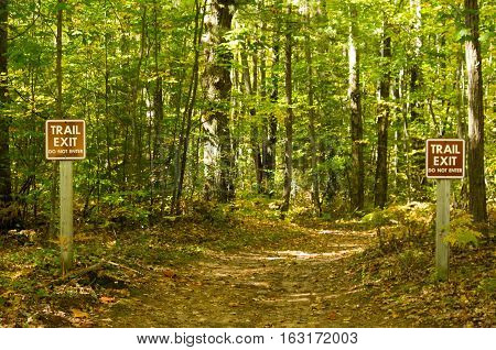 signs marking the exit of a wilderness trail