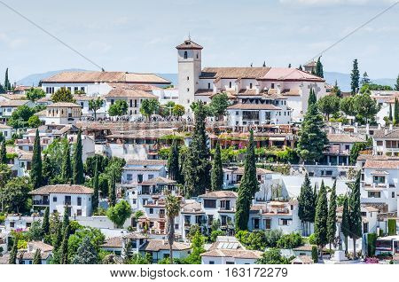 A view of sunny Granada in Andalucia Spain seen from the Alhambra.