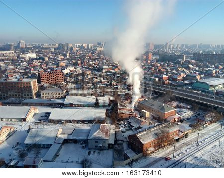 Winter Town. Frosty Sunny Day In The City. Snow On The Streets And Smoke From The Boiler Rises. Fros