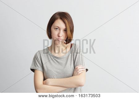 Offended Girl Crooses Hands And Compresses Lips