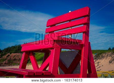 Red wooden lifeguard chair in prince edward island