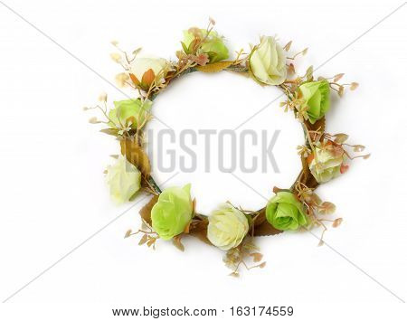Top view of colorful fake flower crown or forest coronal isolated on white background.