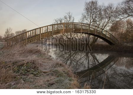 Wooden Footbrige over River Thames on a frosty winters morning near Buscot Oxfordshire