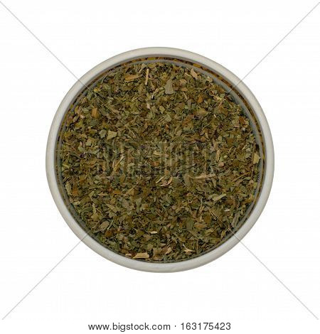 Basilicum spices - Dried basil leaves in a small dish isolated on a white background