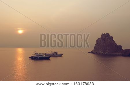 Sunset. Cape Burhan and Shaman Rock on Olkhon Island at Baikal Lake Russia