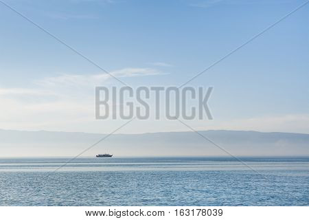 Delicate blue tone of Lake Baikal in calm weather. Beautiful summer morning. Siberia Russia.