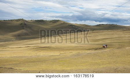 Steppe in Siberian. Baikal. Mountains. Prairie. Blue sky. Rural. Adventure